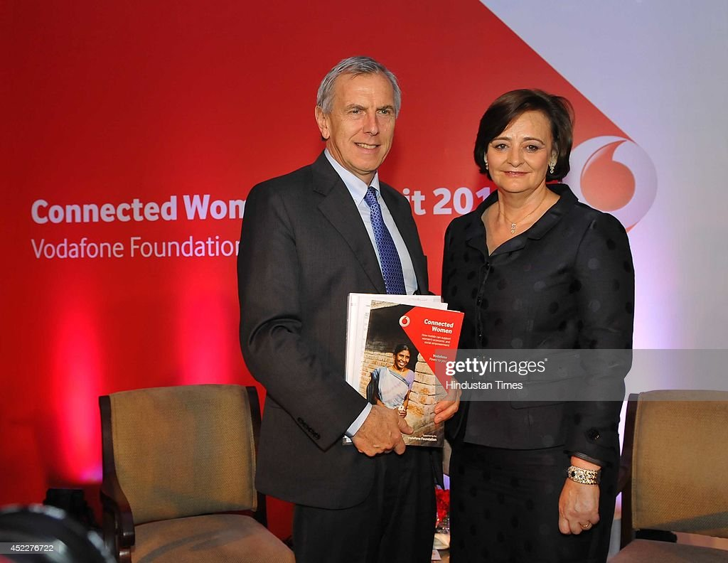 Managing Director and CEO, Vodafone India, Marten Pieters (L) and Cherie Blair (R), founder Cherie Blair Foundation for women, release the Vodafone connected women report 2014 on July 17, 2014 in New Delhi, India. According to the released report, providing women with greater access to mobile phones and services could lead to a 29 billion dollar increase in annual global productivity from 2020, as a result of greater female participation in the workforce and savings in public services.