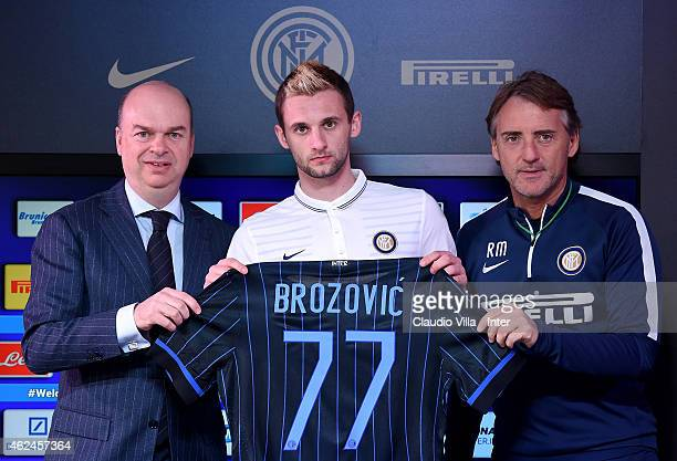 Managing Director and COO Marco Fassone Marcelo Brozovic and Head coach Roberto Mancini pose for a photo during a press conference at Appiano Gentile...