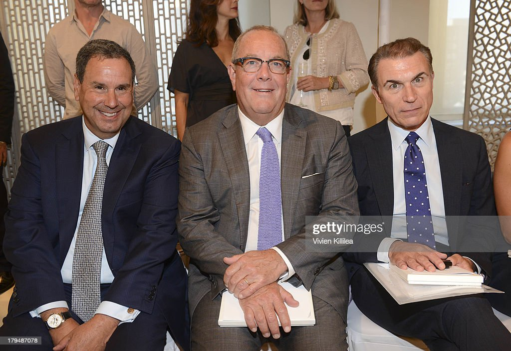 Managing Director at Bank of America Steve Sadoff, President and Chief merchandising officer of Saks Ron Frash and Group Senior Vice President and General Merchandise Manager of Saks Joe Boitano attend the Josie Natori show during Mercedes-Benz Fashion Week Spring 2014 on September 4, 2013 in New York City.
