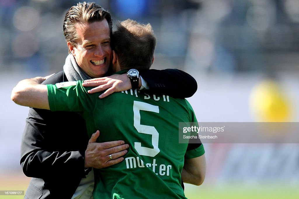 Managing director Carsten Gockel (L) of Muenster and Patrick Kirsch (R) of Muenster hug each other after the 3. Liga match between Preussen Muenster and Karlsruher SC at Preussenstadion on April 20, 2013 in Muenster, Germany.