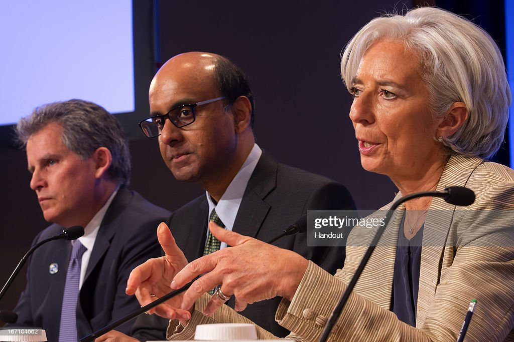 Managing Director Christine Lagarde (R) and Chairman of the IMFC Tharman Shanmugaratnam (C) and IMF FIrst Deputy Managing Director David Lipton (L) hold a joint press coference after their meeting April 20, 2013 at the IMF Headquarters in Washington, DC. The IMF/World Bank Meetings are being held in Washington, DC.