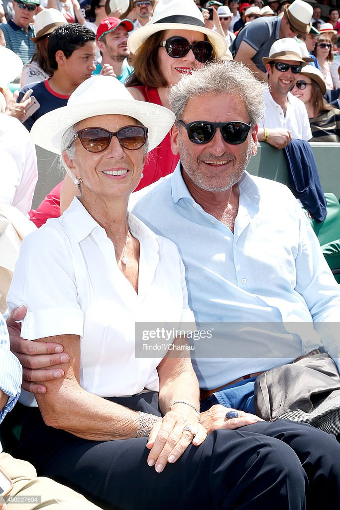 Managing Director <a gi-track='captionPersonalityLinkClicked' href=/galleries/search?phrase=Christine+Lagarde&family=editorial&specificpeople=566337 ng-click='$event.stopPropagation()'>Christine Lagarde</a> and her husband <a gi-track='captionPersonalityLinkClicked' href=/galleries/search?phrase=Xavier+Giocanti&family=editorial&specificpeople=7079753 ng-click='$event.stopPropagation()'>Xavier Giocanti</a> attend the Roland Garros French Tennis Open 2014 - Day 14 on June 7, 2014 in Paris, France.