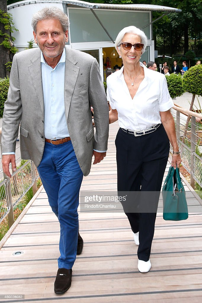 Managing Director <a gi-track='captionPersonalityLinkClicked' href=/galleries/search?phrase=Christine+Lagarde&family=editorial&specificpeople=566337 ng-click='$event.stopPropagation()'>Christine Lagarde</a> (R) and her husband <a gi-track='captionPersonalityLinkClicked' href=/galleries/search?phrase=Xavier+Giocanti&family=editorial&specificpeople=7079753 ng-click='$event.stopPropagation()'>Xavier Giocanti</a> attend the Roland Garros French Tennis Open 2014 - Day 14 on June 7, 2014 in Paris, France.