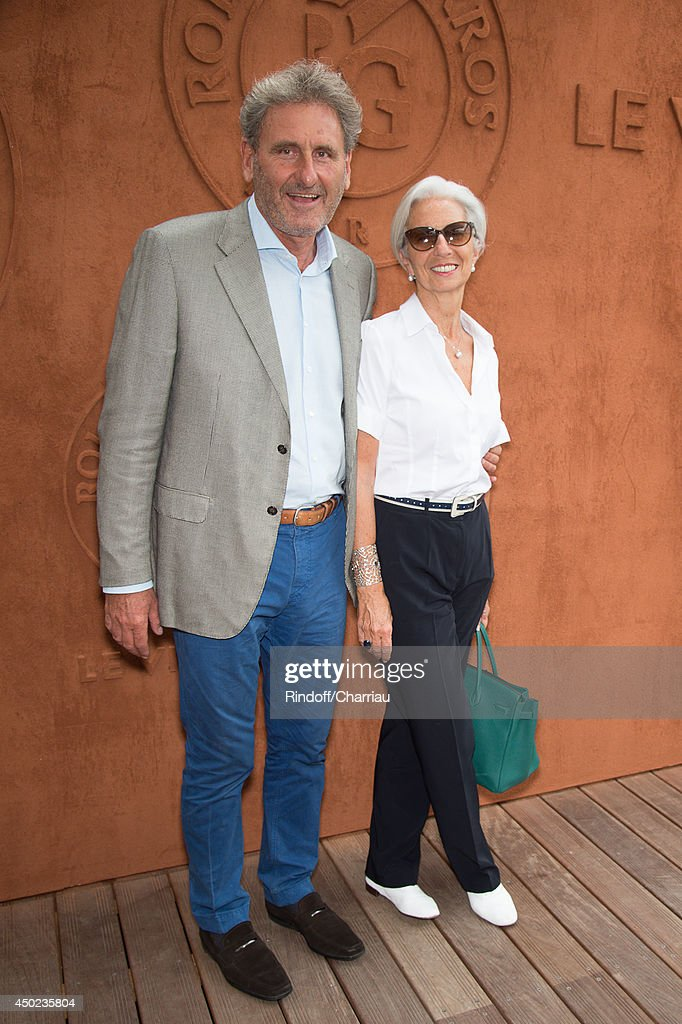 Managing Director <a gi-track='captionPersonalityLinkClicked' href=/galleries/search?phrase=Christine+Lagarde&family=editorial&specificpeople=566337 ng-click='$event.stopPropagation()'>Christine Lagarde</a> (R) and her husband <a gi-track='captionPersonalityLinkClicked' href=/galleries/search?phrase=Xavier+Giocanti&family=editorial&specificpeople=7079753 ng-click='$event.stopPropagation()'>Xavier Giocanti</a> attend the Roland Garros French Tennis Open 2014 - Day 14 at Roland Garros on June 7, 2014 in Paris, France.