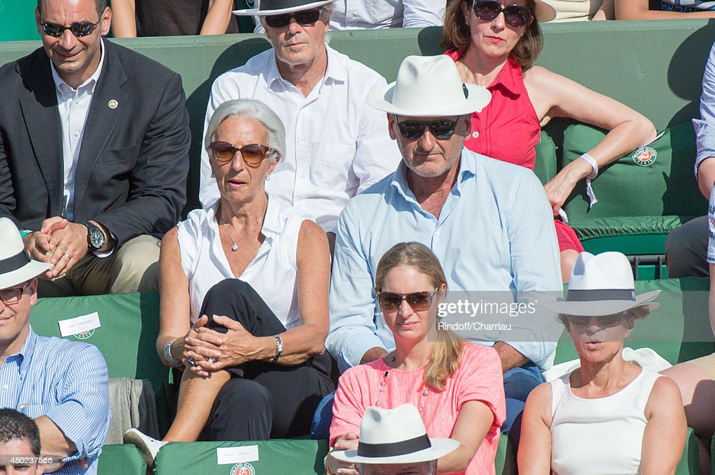 Managing Director Christine Lagarde (L) and her husband Xavier Giocanti attend the Roland Garros French Tennis Open 2014 - Day 14 at Roland Garros on June 7, 2014 in Paris, France.