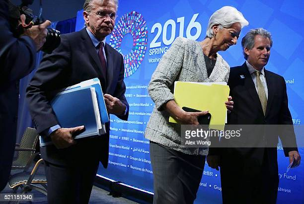 Managing Director Christine Lagarde First Deputy Managing Director David Lipton and Communictions Director Gerry Rice leave after a news conference...
