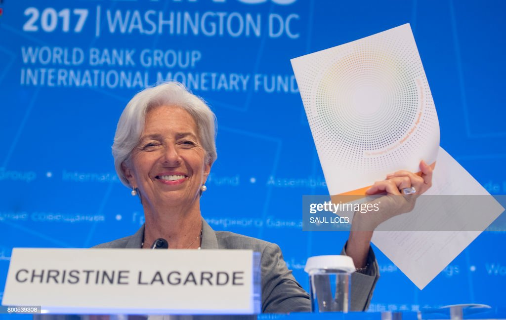 IMF Managing Director Christine Lagarde holds up the Global Policy Agenda during a press conference during the World Bank Group / International Monetary Fund Annual Meetings at IMF Headquarters in Washington, DC, October 12, 2017. /