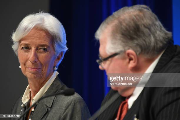 IMF Managing director Christine Lagarde looks at Governor of the Bank of Mexico and Chairman of the International Monetary and Financial Committee...