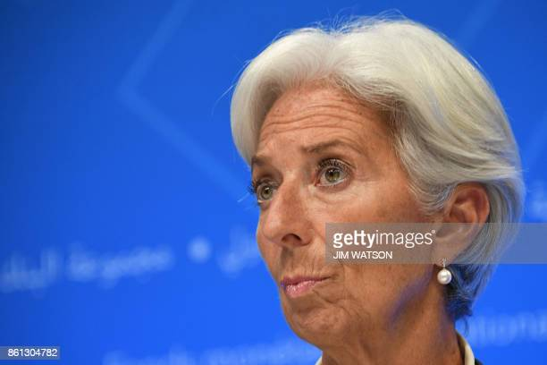 IMF Managing director Christine Lagarde looks on as she attends a press conference at the World Bank and International Monetary Fund annual meeting...
