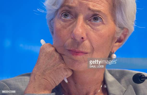 IMF Managing Director Christine Lagarde looks on during a press conference at the World Bank Group / International Monetary Fund Annual Meetings at...