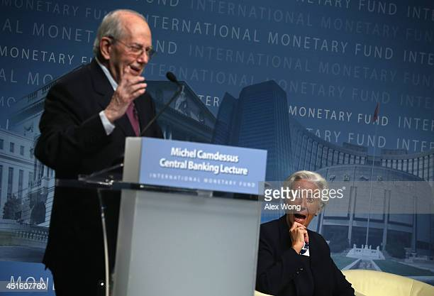 Managing Director Christine Lagarde reacts as former IMF Managing Director Michel Camdessus speaks during a discussion at the International Monetary...