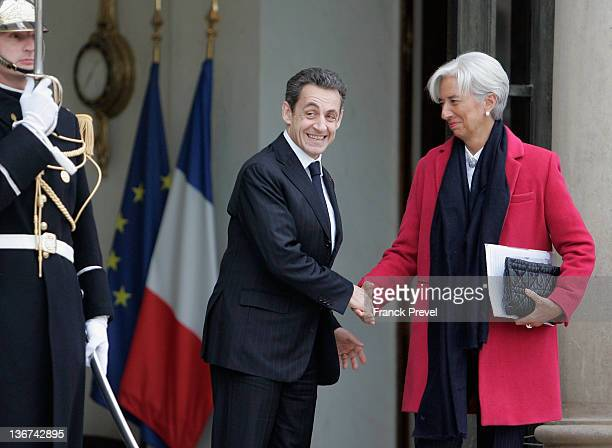 IMF managing director Christine Lagarde shakes hands with French President Nicolas Sarkozy after a meeting at the Elysee Palace on January 11 2012 in...