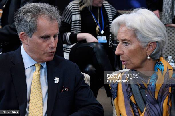 IMF Managing Director Christine Lagarde speaks with David Lipton the IMF's First Deputy Managing Director during a morning plenary session at the...