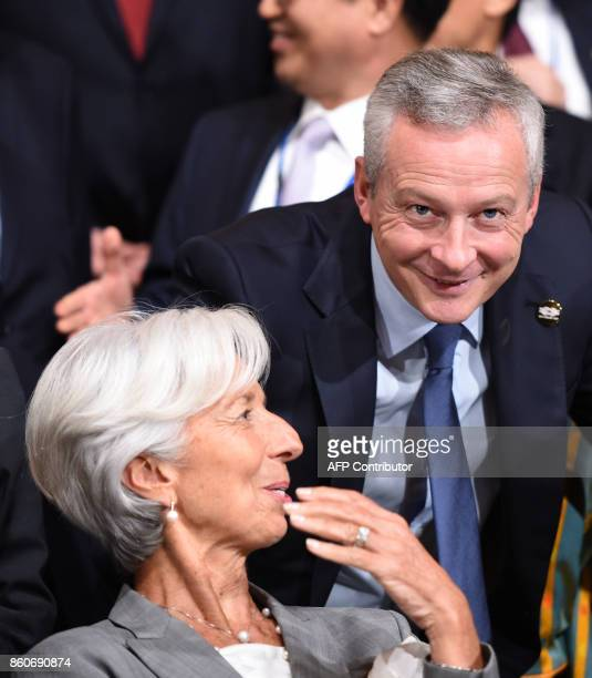 IMF Managing Director Christine Lagarde speaks with French Finance Minister Bruno Le Maire before the G20 Finance ministers group photo at the IMF...