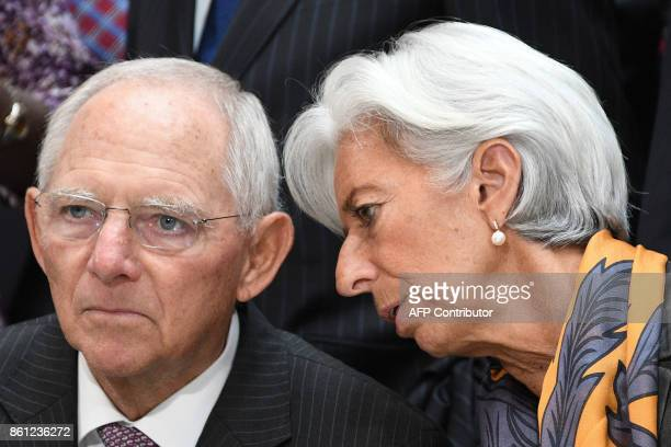 IMF Managing Director Christine Lagarde speaks with German Finance Minister Wolfgang Schaeuble during the family photo at the World Bank and...