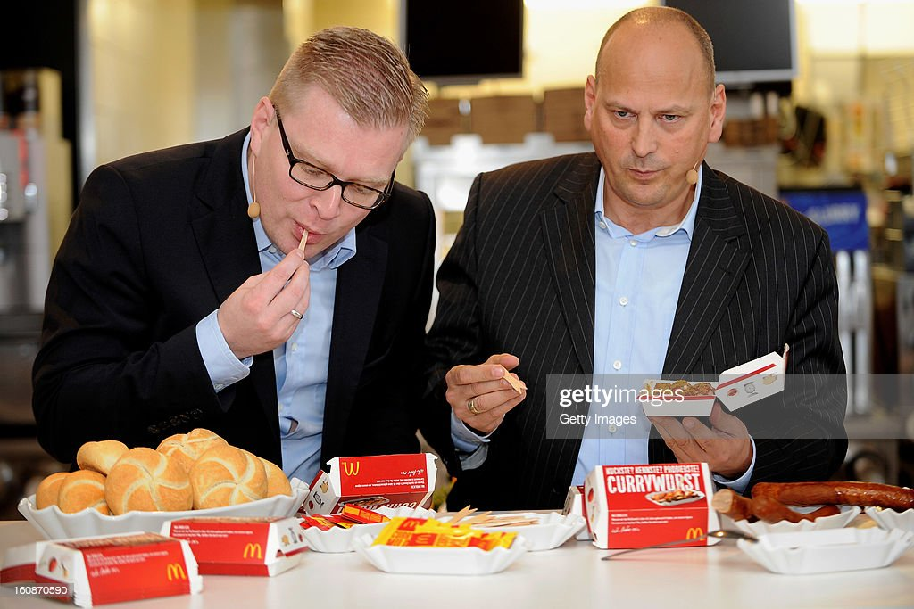 Managing Director HoWe Wurstwaren Florian Hoeneß and Managing Director McDonald's Germany Holger Beeck (l-r) pose during the presentation of McCurrywurst from McDonald's on February 7, 2013 in Dortmund, Germany.