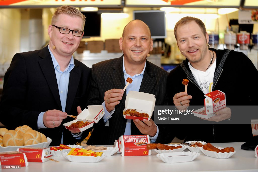 Managing Director HoWe Wurstwaren Florian Hoeneß, Managing Director McDonald's Germany Holger Beeck and Comedian <a gi-track='captionPersonalityLinkClicked' href=/galleries/search?phrase=Mario+Barth&family=editorial&specificpeople=587497 ng-click='$event.stopPropagation()'>Mario Barth</a> (l-r) pose during the presentation of McCurrywurst from McDonald's on February 7, 2013 in Dortmund, Germany.