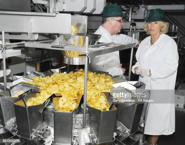 Managing Director Les Sayers with the Duchess of Cornwall during her tour of Tyrrells Potato Chip factory near Leominster Herefordshire