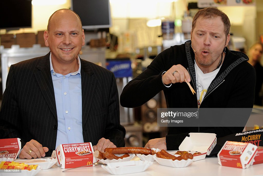 Managing Director McDonald's Germany Holger Beeck and Comedian <a gi-track='captionPersonalityLinkClicked' href=/galleries/search?phrase=Mario+Barth&family=editorial&specificpeople=587497 ng-click='$event.stopPropagation()'>Mario Barth</a> (l-r) pose during the presentation of McCurrywurst from McDonald's on February 7, 2013 in Dortmund, Germany.