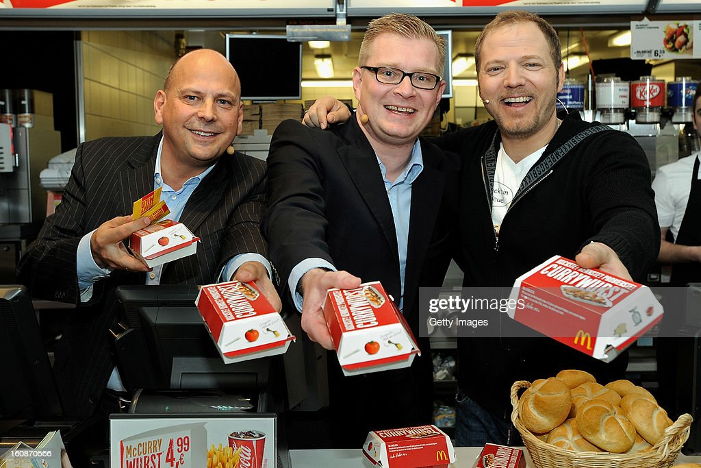 Managing Director McDonald's Germany Holger Beeck, Managing Director HoWe Wurstwaren Florian Hoeneß and Comedian <a gi-track='captionPersonalityLinkClicked' href=/galleries/search?phrase=Mario+Barth&family=editorial&specificpeople=587497 ng-click='$event.stopPropagation()'>Mario Barth</a> (l-r) pose during the presentation of McCurrywurst from McDonald's on February 7, 2013 in Dortmund, Germany.