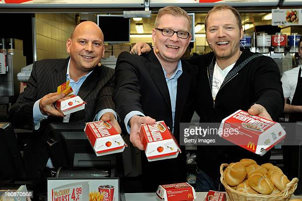 Managing Director McDonald's Germany Holger Beeck Managing Director HoWe Wurstwaren Florian Hoeneß and Comedian Mario Barth pose during the...