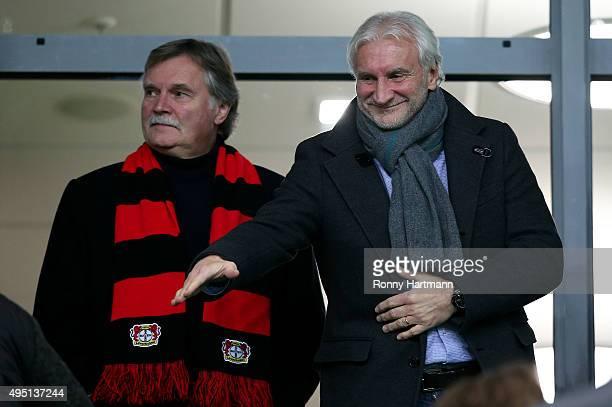 Managing director Michael Schade and sporting director Rudi Voeller of Leverkusen are pictured prior to the Bundesliga match between VfL Wolfsburg...