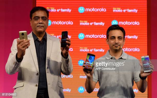 Managing director Motorola Mobility India Sudhin Mathur and product marketing head for Lenovo MBG Anuj Sharma hold up the newly launched Lenovoowned...