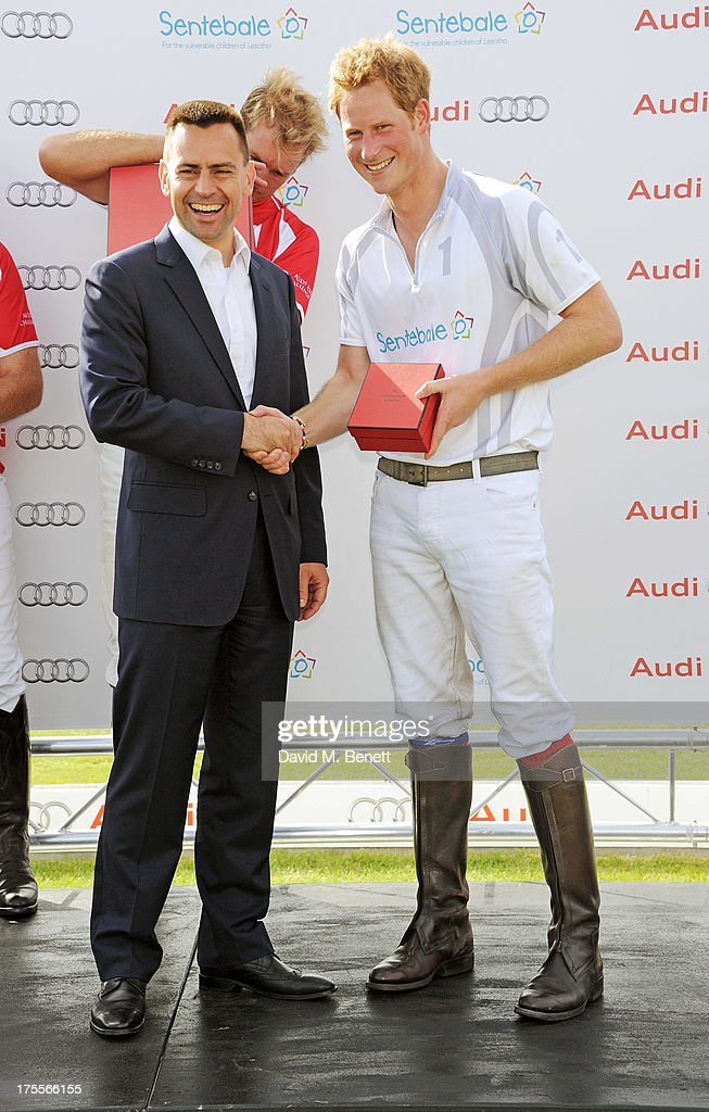 Managing Director of Audi UK Martin Sander (L) and <a gi-track='captionPersonalityLinkClicked' href=/galleries/search?phrase=Prince+Harry&family=editorial&specificpeople=178173 ng-click='$event.stopPropagation()'>Prince Harry</a> attend day 2 of the Audi Polo Challenge at Coworth Park Polo Club on August 4, 2013 in Ascot, England.