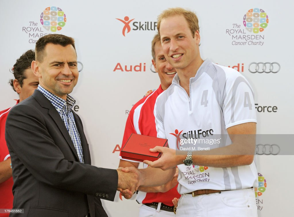 Managing Director of Audi UK Martin Sander (L) and <a gi-track='captionPersonalityLinkClicked' href=/galleries/search?phrase=Prince+William&family=editorial&specificpeople=178205 ng-click='$event.stopPropagation()'>Prince William</a>, Duke of Cambridge, attend day 1 of the Audi Polo Challenge at Coworth Park Polo Club on August 3, 2013 in Ascot, England.