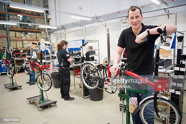Managing Director of Brompton Bikes Will ButlerAdams poses for photographs with a folding bicycle on the production line at the company's...