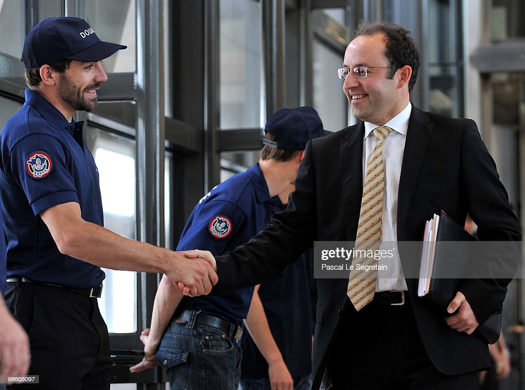 Managing Director of Customs and indirect rights within the Ministry for the Budget, Jerome Fournel (R) shakes hands with <a gi-track='captionPersonalityLinkClicked' href=/galleries/search?phrase=Gauthier+De+Tessieres&family=editorial&specificpeople=871413 ng-click='$event.stopPropagation()'>Gauthier De Tessieres</a> before a press conference to announce Customs results for 2009 at Ministere des Finances on April 22, 2010 in Paris, France.