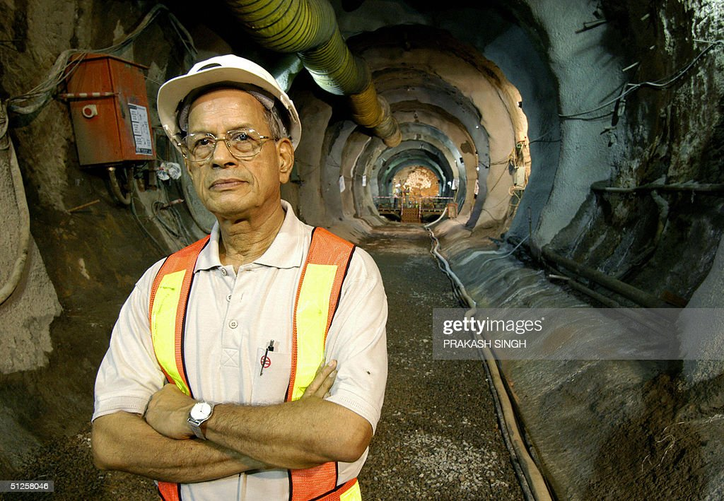 Managing Director of Delhi Metro Rail Corporation E Sreedharan poses after watching a Rock Tunnel Boring Machine break through the last tunnel...
