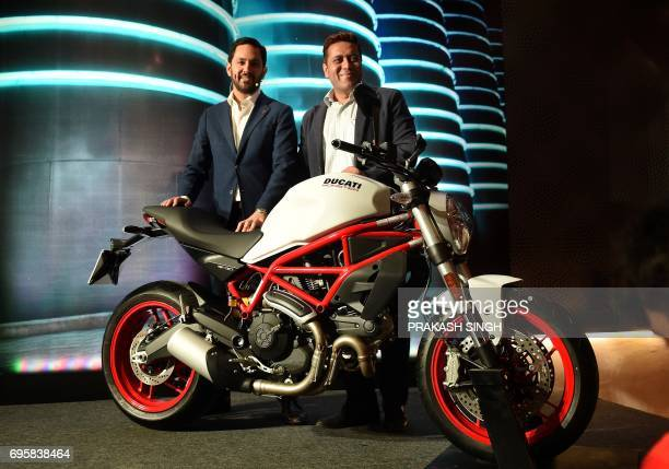 CORRECTION Managing Director of Ducati India Ravi Avalur and Director of Operations Ducati India Yogesh Phogat pose for a photograph during the...