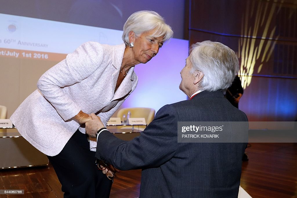 Managing Director of International Monetary Fund Christine Lagarde (L) shakes hands with honorary Governor of Banque de France Christian Noyer during the 60th anniversary of the Paris Club, on July 1, 2016 in Paris. KOVARIK