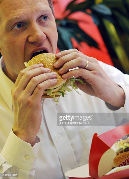 BALAZS Managing director of McDonalds Hungary Czech Radek Janalik tastes a sandwich on May 27 2008 as hundreds of people lined up to celebrate the US...