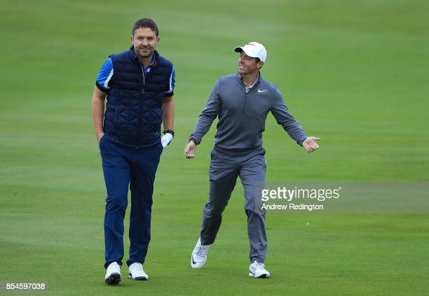 Managing Director of Sky Sports Barney Francis and Rory McIlroy of Northern Ireland share a joke on the 3rd hole ahead of the British Masters at...