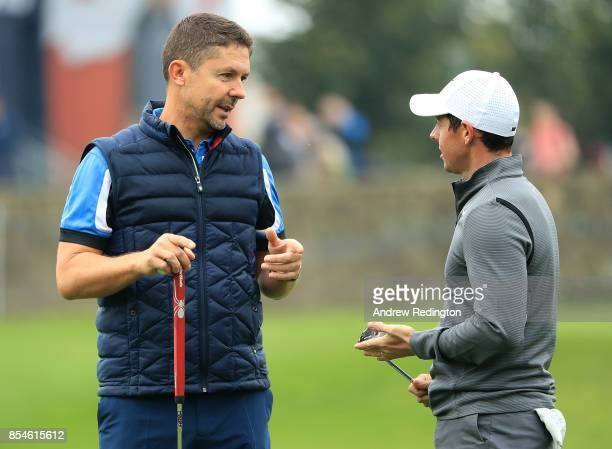 Managing Director of Sky Sports Barney Francis and Rory McIlroy of Northern Ireland speak during the pro am ahead of the British Masters at Close...