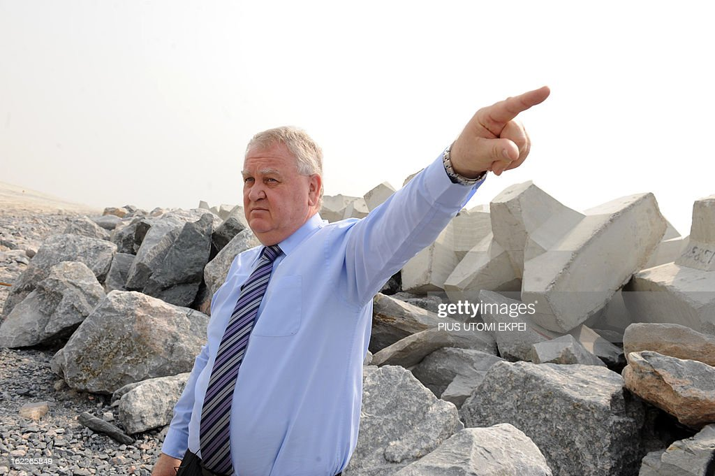Managing Director of South Energyx Nigeria limited David Frame gestures, on January 31, 2013 in Lagos, at the building site of the three and a half kilometre long sea defence barrier called 'The Great Wall of Lagos' built to shield from coastal erosion Eko Atlantic, a new city born from the Altantic ocean in Lagos. Nigeria's President Goodluck Jonathan and former US President Bill Clinton dedicated on February 21, 2013 the new 5-million-square-metre Eko Atlantic City, which is to be the first modern smart city in Africa to be built on reclaimed land from the Atlantic Ocean.
