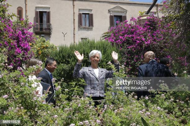 Managing Director of the International Monetary Fund Christine Lagarde wavess after a family photo with participants of the G7 summit during the...