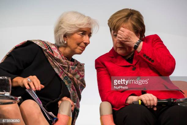 Managing Director of the International Monetary Fund Christine Lagarde and German Chancellor Angela Merkel are pictured during the Woman 20 Summit in...