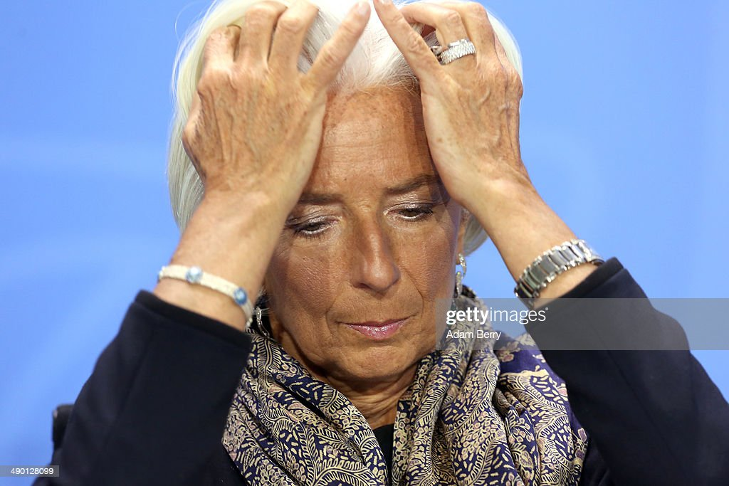 Managing Director of the International Monetary Fund (IMF) <a gi-track='captionPersonalityLinkClicked' href=/galleries/search?phrase=Christine+Lagarde&family=editorial&specificpeople=566337 ng-click='$event.stopPropagation()'>Christine Lagarde</a> listens at a news conference in the German federal Chancellery on May 13, 2014 in Berlin, Germany. World finance, economic and labor leaders met with the German chancellor today, after a weekend upon which she reiterated her stance on the importance of regulation of global finance markets.