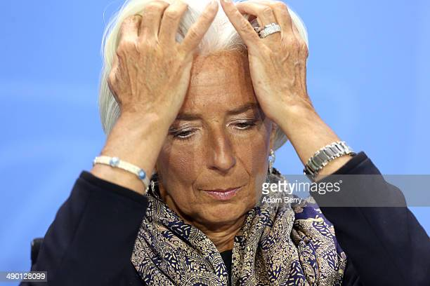 Managing Director of the International Monetary Fund Christine Lagarde listens at a news conference in the German federal Chancellery on May 13 2014...