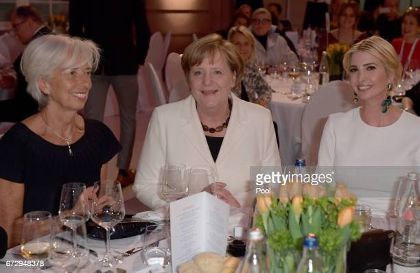 Managing Director of the International Monetary Fund Christine Lagarde German Chancellor Angela Merkel and Ivanka Trump daughter of US President...