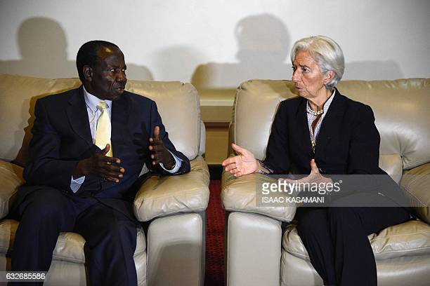 Managing Director of the International Monetary Fund Christine Lagarde seats with Ugandas Minister of Finance Planning and Economic Development Matia...