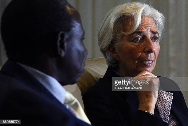 Managing Director of the International Monetary Fund Christine Lagarde talks with Ugandas Minister of Finance Planning and Economic Development Matia...