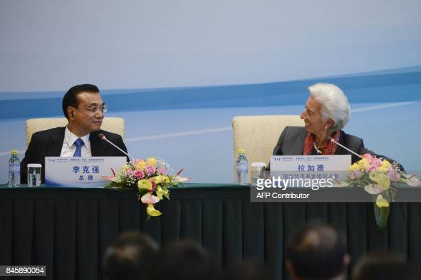 Managing Director of the International Monetary Fund Christine Lagarde talks with Chinese Premier Li Keqiang during a press conference following the...
