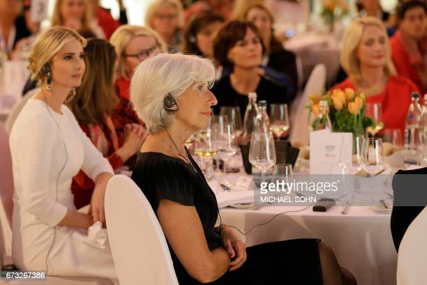 Managing Director of the International Monetary Fund Christine Lagarde listens to a speech of German Chancellor Angela Merkel during a dinner after...