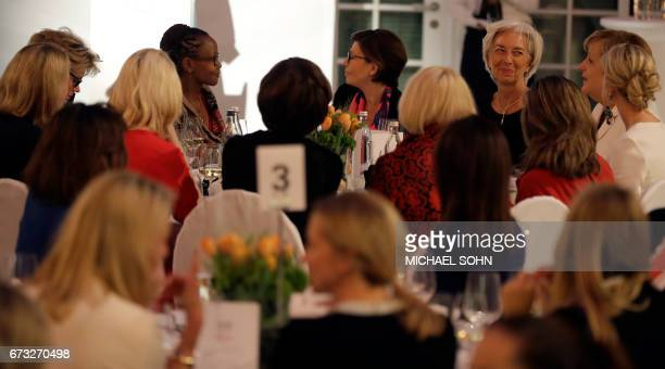 Managing Director of the International Monetary Fund Christine Lagarde smiles to German Chancellor Angela Merkel during a dinner after they...