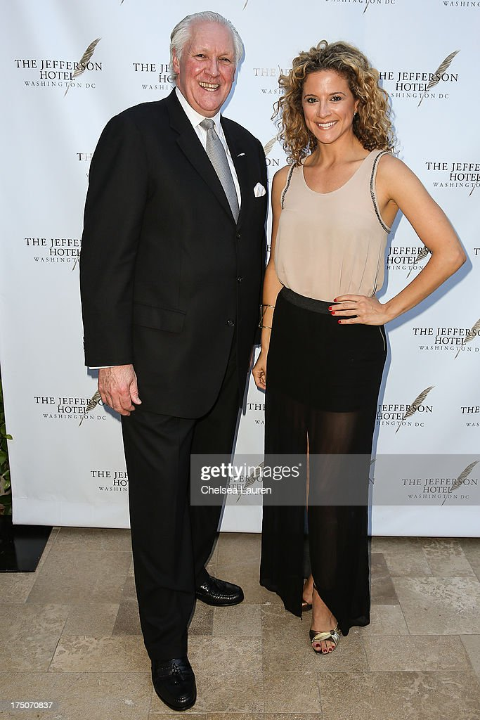 Managing director of The Jefferson Hotel Philip A. Wood (L) and actress Alexis Carra attend The Jefferson Hotel D.C. vintage wine tasting summer soiree at Hotel Bel-Air on July 30, 2013 in Los Angeles, California.