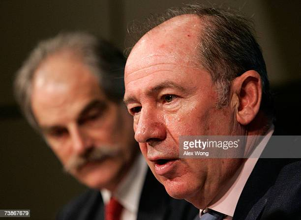 Managing Director Rodrigo de Rato speaks as his deputy John Lipsky listens at a news conference at the IMF headquarters April 12 2007 in Washington...